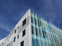 100 Diagonal office building - insulated sandwich panels. Liner and sandblast finish on white concrete.