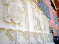Facade panel for a historic theater in Chicago IL, form liner on acid-washed white concrete. Decorative concrete.